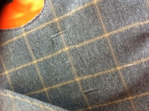 The breast welt of the coat matched both ways.