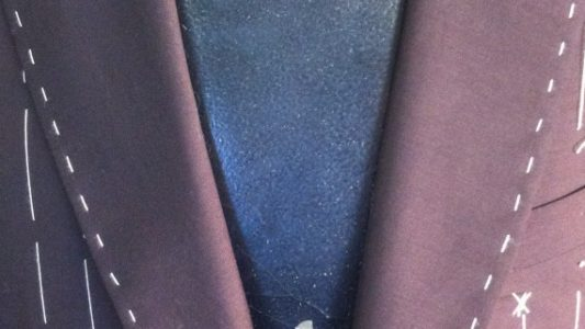 Bespoke mohair coat waiting for the sleeves to be hand basted in for a forward fitting.